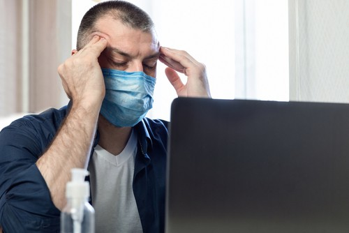 stressed man in mask